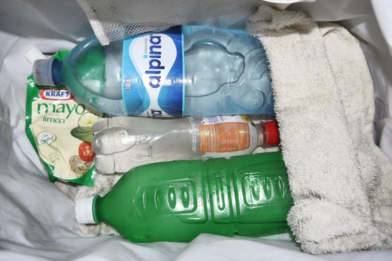 use frozen bottles of water instead of ice for survivalist living out of a cooler, use rage under and over the bottles to trap condensation, www.retartexperiment.com